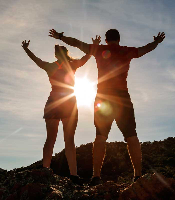 Wellness Image couple exercising happy getting better by working together Banu Acan DPT